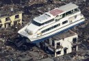 Pleasure boat suspended over house roof after the Fukushima tsunami